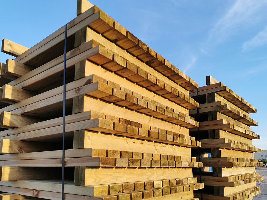 wooden euro pallets stacked against the sky in the warehouse