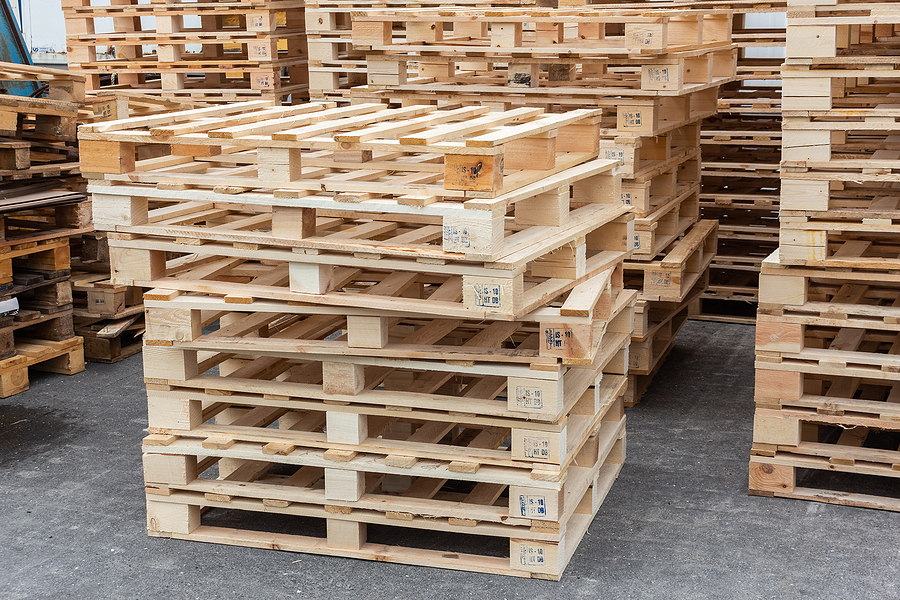 many pallets stacked in stock, warehouse pallets